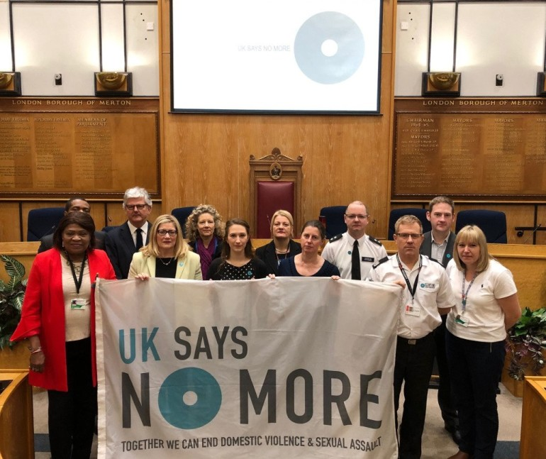 Cabinet Member for Children's Services Cllr Kelly Braund and Cabinet Member for Community Safety, Engagement and Equalities Cllr Edith Macauley with partners and officers supporting the international campaign against domestic violence and sexual assault.